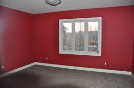 a living room with deep red paint .