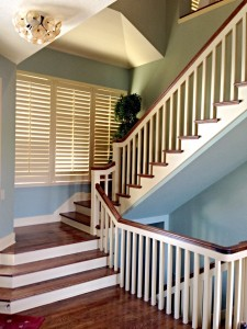 kansas city interior house painters shows blue staircases with white rails