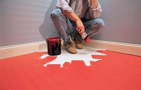 small blotchy red paint on the floor