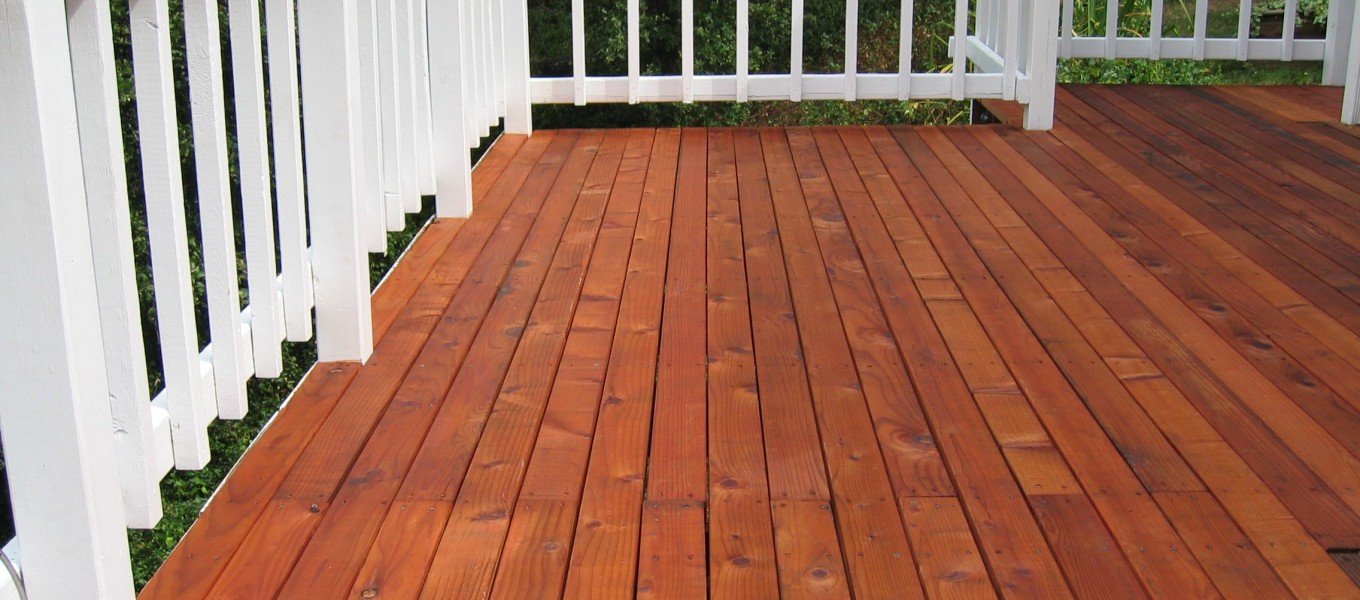 a deck is stained and not painted in olathe kansas, using brown dark stain