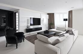 a room is all white, walls, furniture and decor