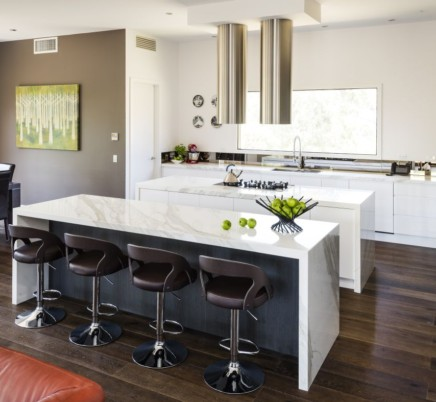 a modern kitchen is painted totally white including the bench and walls