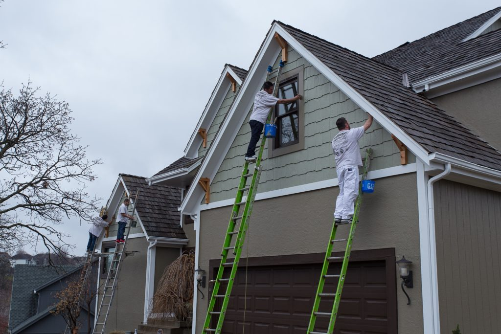 Painting process for residential exterior.