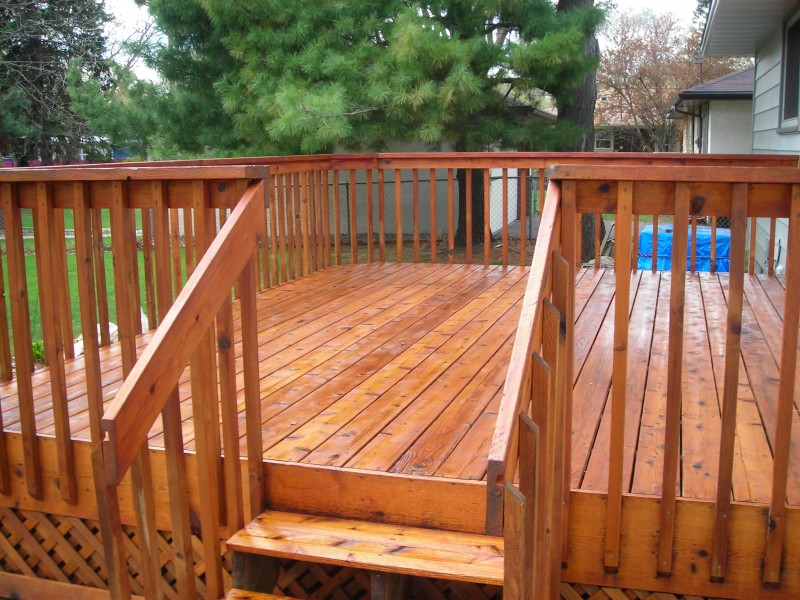 a deck is stained light brown and finished with gloss