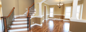 a home is painted light brown and dark brown