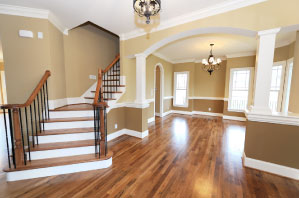 an Olathe house is painted beige and tan with wood floors