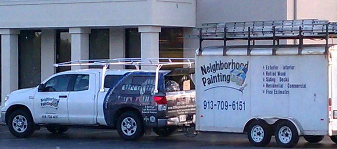 A local painting company pulls it's trailer behind a truck