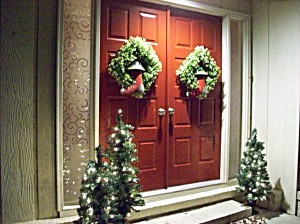 A house's front door is painted deep red to offset the gray border