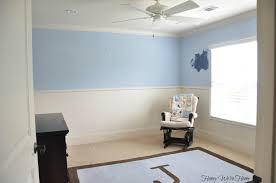 a room is painted light blue with a white stripe