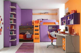 a kids room is painted orange and purple