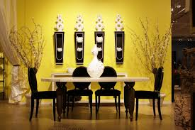 a room is painted light yellow and decorated with brown furniture