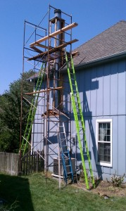 wood rot is replaced on a blue house in blue springs missouri