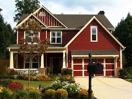 A Johnson County Home Has A Deep, Red Color And White Trim Paint Job From