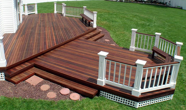 Another Deep Dark Brown Stained Deck Is Completed In Lenexa Kansas With White Wood Trim