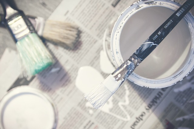 Paint Brush Resting on Can of White Paint